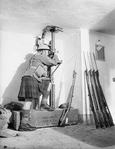 A soldier from the Cameron Highlanders looks through a periscope in the Fort de Sainghain on the Maginot Line, 3 November 1939.