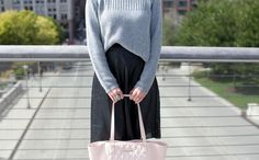 Leather skirt and grey sweater tucked in