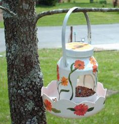 Recycle and create a pretty Spring Bird Feeder from used McDonald's Happy Meal bucket and plastic mayonnaise jar.