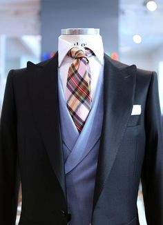 Add Gatsby inspired sophistication to your wardrobe with pinstripes, silk ties, vests and club collars.