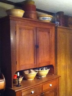 Popular 2 Piece Wall Cupboard With Pie Shelf Filled With Yellowware Pottery.