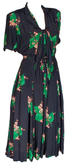 1940s Tropical Print Rayon Dress at ballyhoovintage.com Perfect summer dress that you could wear into fall! Women's vintage fall fashion clothing outfit