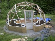 2V Geodesic Dome Greenhouse built with 2x4 beams and pipe hubs. It has an IBC tote aquaphonics system in it and strawberry towers.
