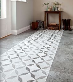 Concrete floor with a feature tile in the middle. Could be nice for the hallway... like a tile runner?