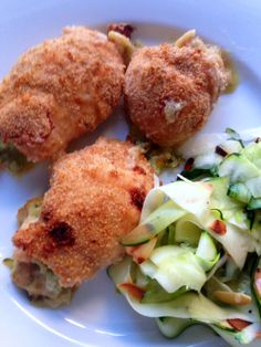 Chicken stuffed with Zucchini and Mozzarella in a lemon wash - soooo good. andwhatiate.com #recipes