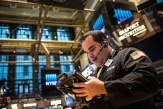 A trader works on the floor of the New York Stock Exchange during the afternoon of November 4, 2014 in New York City.