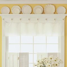 Kitchen window treatment - perfect for the window! white shutters, add mini shelf space to top and display white and off white plates and simple valance.