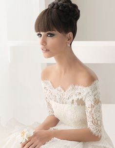 gorgeous off shoulder wedding dress with lace and sleeves. love the blunt bangs with this look