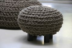Stool crocheted of olivegreen wool, on wengé colored legs. Size: cross 50 cm, height 35 cm. Available in: ecru, grey/white, light grey, dark grey, olive green, mustard green, turquoise, dark blue, purple, old rose, terra, orange.