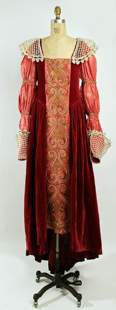 "Embroidered pink silk brocade and red velvet ""Elizabethan"" fancy dress costume with faux pearl collar, cuffs, and beading, by Paul Poiret, French, 1900-1914."