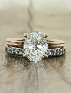 A delicate double band in rose gold sets the stage for a unique ring. An oval diamond provides the sparkle. Contact us to customize the gemstone and metal.