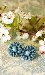 The rich turquoise gemstones on these sunburst studs pair beautifully with everything from brights to neutrals, making for the perfect summer jewelry piece.