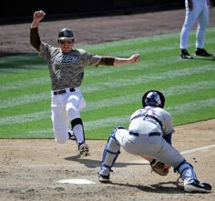 Game #111 8/5/12: John Baker #21 of the San Diego Padres scores ahead of the tag of Rob Johnson #16 of the New York Mets during the eighth inning of a baseball game at Petco Park on August 5, 2012 in San Diego, California. The Padres won 7-3. (Photo by Denis Poroy/Getty Images)