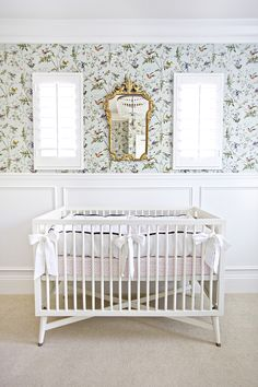 Dwell Studio Mid-Century French White Crib Sweet Nursery by Shea McGee Design featuring Cole & Son Hummingbird Wallpaper