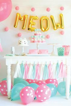 This kitty-themed party is just purr-fect for the cat-loving toddler in your life! See the full photo collection and gather inspiration and party ideas from all the adorable details including DIY yarn ball garland and a kitty face cake. Your little girl will absolutely love it!