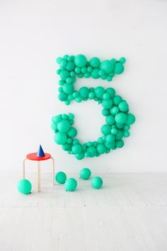 What can be more fun than making up your kids birthday age in a giant balloon sculpture? You can go for a single colour or choose a range of colours.  This DIY giant balloon number makes an oversized decoration and a great backdrop for photos too https://petitandsmall.com/7-diy-balloon-ideas-make-kids-party/