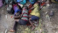 Sick Burundian refugees sleep as they wait for treatment at a makeshift clinic on the shores of Lake... - Thomas Mukoya/Reuters