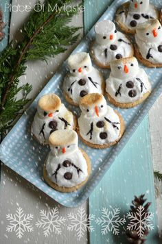 Melted Snowman Cookies - decorating store-bought cookies with marshmellows?  . . . but they are cute