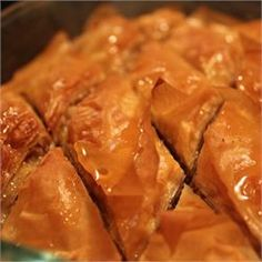 Baklava uses phyllo dough stacked with honey and nuts to make a sweet Mediterranean dessert that everyone will love. Just Desserts, Delicious Desserts, Dessert Recipes, Yummy Food, Pasta Filo, Baklava Recipe, Phyllo Dough, Cupcakes, Middle Eastern Recipes