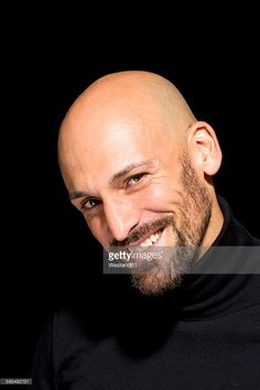 Stock Photo : Portrait of smiling bald man with wearing black turtleneck in front of black background Bald Head Man, Bald Boy, Bald Head With Beard, Bald Men With Beards, Mens Hairstyles With Beard, Haircuts For Men, Bald Men Style, Male Pattern Baldness, Shaved Head