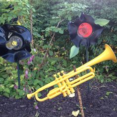 Painted instruments and old vinyl records melted into flowers for the garden!