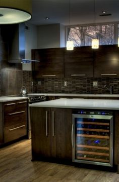 dark cabinets, windows above the cabinets