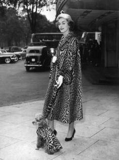 Full-length image of a woman standing with her poodle on a sidewalk, each wearing a matching leopard-spotted fur coat. (Photo by Hulton Archive/Getty Images) 1945 Vintage Fur, Vintage Mode, Vintage Glamour, Vintage Style, Poodles, Leopard Fur Coat, Retro Fashion, Vintage Fashion, Sporty Fashion