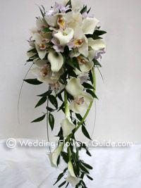 wedding bouquet of calla lilies, orchids and freesias