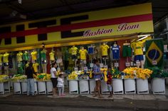 A clothing store displays mostly Brazilian-colored garments in Rocinha shantytown (favela) in Rio de Janeiro, Brazil on June 9, 2014; just 3 days before the opening of the FIFA World Cup 2014.