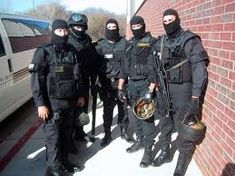 They have specialized equipment including heavy body armor, ballistic shields, entry tools, armored vehicles, advanced night vision optics  http://lfgcommandsystems.com/our_users