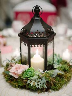 Add succulents into a mossy mixture around a lantern for a trendy touch on your romantic, fairy tale centerpieces.