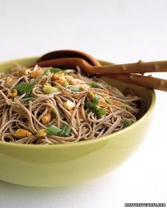 Dress Japanese somen noodles in a snappy dressing of grated ginger, lime zest, and rice-wine vinegar, and top with scallions and roasted peanuts. Somen noodles are available in the Asian section of many supermarkets; you may substitute vermicelli or thin spaghetti.