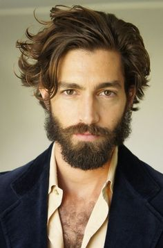 Longer on top hairstyle, with full beard