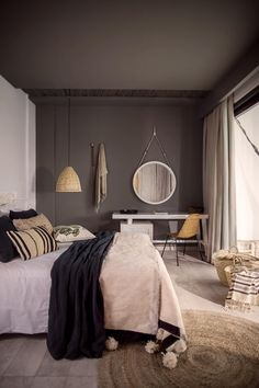 This is a great way to make grey feel really warm in a bedroom space. Love the jute rug and moroccan pom pom blanket.