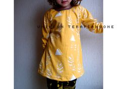 Yellow Feather Tunic by Unikuun terapiahuone. This fabric is printed by hand.