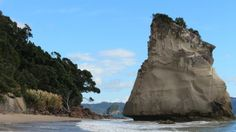 Cathedral Cove, Auckland - An iconic attraction in the Coromandel. A 45 minute walk on foot (no access by vehicle) will take you one of the most photographed spots in New Zealand. Auckland, New Zealand, Mount Rushmore, Cathedral, Things To Do, Rock, Mountains, Water, Travel