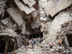 A man walks amid destruction in Aleppo, Syria. A top U. official said the United States is mulling ways to step up support for the Syrian opposition. Syrian Civil War, Refugee Crisis, Syrian Refugees, Aleppo, Mail Art, Palestine, Destruction, Apocalypse, Civilization