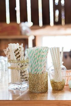 Cocktail Bar Ideas: Glitter covered jar with striped straws.