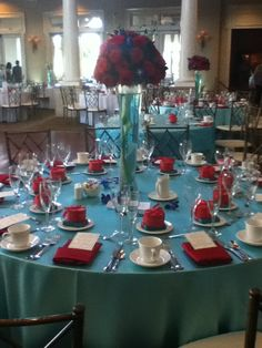 Teal and red wedding table arrangements