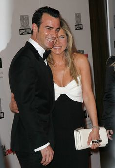 Jennifer Aniston and Justin Theroux get cute on the red carpet. @Celebstylewed