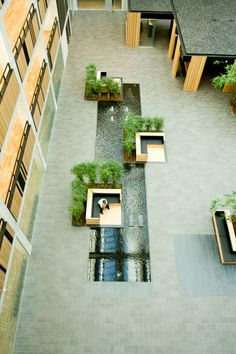(like wurster design) courtyard garden / VAT83 Multi-User Office | PLH Arkitekter ...seating interjecting water feature
