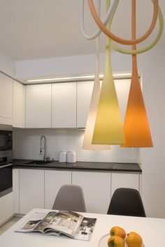 Apartment: Minimalist Krakow Apartment Designed by Morpho Studio, Krakow Apartment L-shaped Kitchen with White Cabinetry and Colorful Pendant Light Designed by Morpho Studio