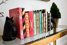 Use Annie Sloan Chalk Paint and Royal Design Studio stencils to decorate hardcover books for glam DIY bookcovers - Stencils from www.royaldesignstudio.com