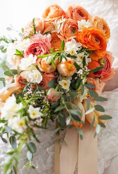 Brides: Orange Bouquet of Roses and Ranunculuses ,Bouquet of ranunculuses, garden roses, narcissus, citrus blossoms, parrot tulips, and seeded eucalyptus, $425, Finch & Thistle Event Design Photo: Jose Villa