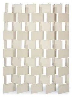 EILEEN GRAY (1879-1976)  A Painted Wood 'Brick' Screen, 1923  composed of 45 large and ten small white-painted wood panels, articulated on steel rods  83½ in. (212 cm.) high, 63 in. (160 cm.) wide approximately  (Christie's)