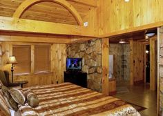 A bedroom in the Downtown Delight cabin in Gatlinburg.