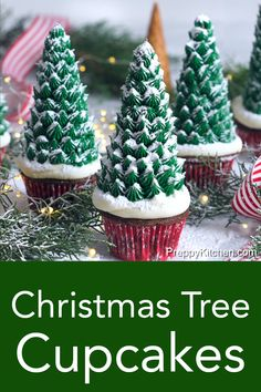 Rich, moist chocolate cupcakes from Preppy Kitchen are topped with easy to make, and quite festive, Christmas trees made from ice cream cones, some buttercream and a dusting of powdered sugar for snow! #christmastreecupcakes #holidaycupcakes #bestcupcakes