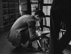 Oxford student goes through a book on sale. Photographed by John Chillingworth, England, 1950