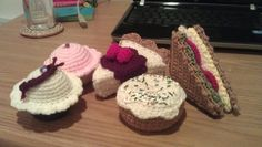 Crochet food: cupcakes from http://bittersweetblog.com/2007/08/14/bake-me-a-cake/ raspberry cheesecake (cant find the website i learned how to make the cheesecake part) donut from http://www.lionbrand.com/patterns/80114AD.html ham and cheese sandwich from my mastermind.