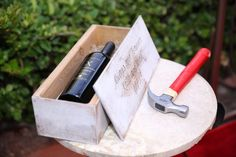"""Break away from the traditional unity ceremony. This couple sealed a classy bottle of wine in a \""""time capsule\"""" with secret love letters. The box was to be opened and enjoyed on their 5th anniversary! #victoriasfamilyweddings #lasvegaswedding"""